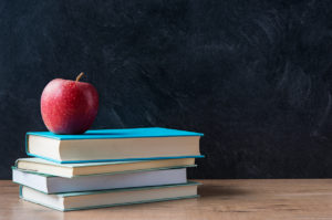 Picture of school books with an apple